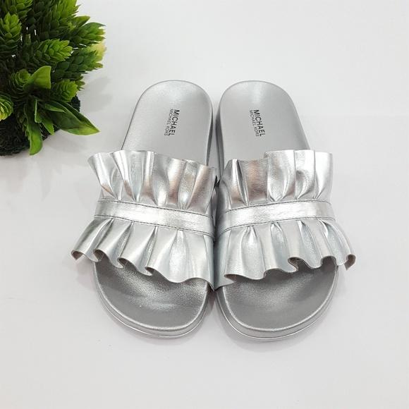 eca902104e12 NEW Michael Kors Silver Bella Sport Slide Sandals.  M 5b7224fe619745a324571a59